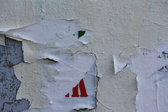 Torn posters. Close-up view of torn posters on cracked plaster royalty free stock image