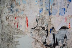Torn posters. Colorful torn posters on grunge old walls as creative and abstract background royalty free stock images