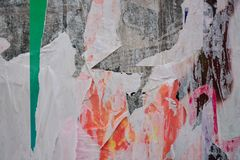 Torn posters. Colorful torn posters on grunge old walls as creative and abstract background royalty free stock photo