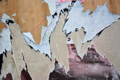 Torn posters. Colorful torn posters on grunge old walls as creative and abstract background Stock Image