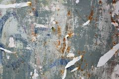 Torn posters. Colorful torn posters on grunge old walls as creative and abstract background Stock Images