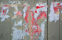 Torn posters. Colorful torn posters on grunge old walls as creative and abstract background Royalty Free Stock Photos