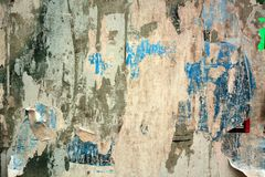Torn posters. Colorful torn posters on grunge old walls as creative and abstract background Stock Photos