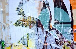 Torn posters. Colorful torn posters on grunge old walls as creative and abstract background Stock Photography