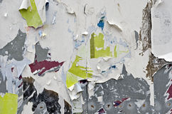 Torn Posters. Old torn posters on grungy zinc wall royalty free stock images