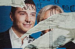 Torn posters of political party leaders ones of the candidates running in the May 2019 european elections royalty free stock photo