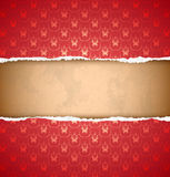 Torn red ornamental wallpaper Royalty Free Stock Image
