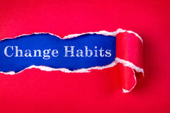 Torn red Paper and Change Habits text with  a blue paper backgro Royalty Free Stock Photos