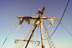 Torn sails. Mast of the old ship with torn sails Royalty Free Stock Image