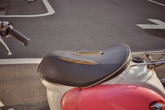 Torn scooter black saddle. Along Tokyo street abstract auto automobile automotive background broken business car chair closeup color colorful damaged design stock image