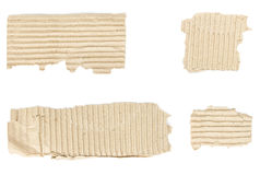 Torn scraps from cardboard box with copy-space isolated Royalty Free Stock Photography