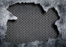 Torn steel with a gray mesh background damaged metal. Texture torn metal mesh weathered iron as background Stock Images