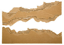 Torn strips of cardboard. The ragged brown cardboard chunks form border, corners and edges for adding text.  The background is white isolated Stock Photo