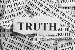 Torn Truth. Torn pieces of paper with the word Truth. Black and White. Close-up royalty free stock photo