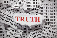Torn Truth. Torn pieces of paper with the word Truth. Close-up stock photography