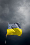 Torn Ukrainian flag on the background of a stormy Stock Photo