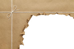 Torn Up Package. Brown Paper Package with Rope Torn Open on White Background royalty free stock photo