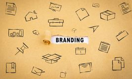 Torn-up paper labeled branding Stock Photo