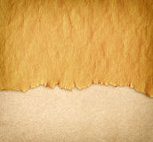 Torn vintage paper over canvas with paint background Royalty Free Stock Photos