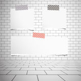 Torn white blank paper sheets stuck on gray brick wall Stock Photo