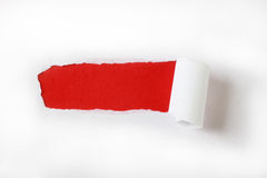 Torn white paper with red paper