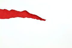 Torn white paper with red paper inside Stock Photography