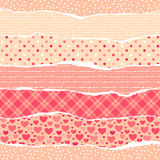 Torn wrapping paper with hearts. Royalty Free Stock Photos