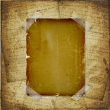Torn yellow paper fastened with masking tape Royalty Free Stock Photography