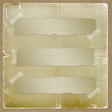 Torn yellow paper fastened with masking tape Stock Photos