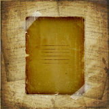 Torn yellow paper fastened with masking tape Royalty Free Stock Photo