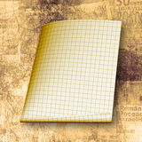 Torn yellow sheet on the paper background Stock Image