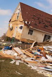 Tornado aftermath in Lapeer, MI. LAPEER COUNTY, MI - MARCH 16: A home heavily damaged by an F2 tornado that swept through Oregon Twp in Lapeer County, MI on stock photo