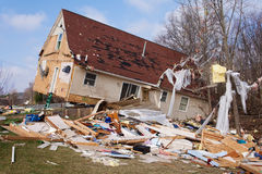 Tornado aftermath in Lapeer, MI. LAPEER COUNTY, MI - MARCH 16: A home heavily damaged by an F2 tornado that swept through Oregon Twp in Lapeer County, MI on royalty free stock photos