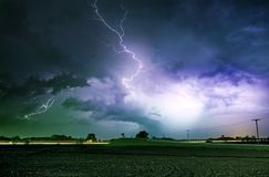 Tornado Alley Severe Storm. At Night Time. Severe Lightnings Above Farmlands in Illinois, USA. Severe Weather Photography Collection Royalty Free Stock Photo