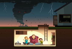 Tornado Attack!. A family hiding from the raging tornado inside an underground bunker Stock Images