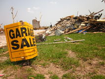 Tornado damage with garage sale sign. Garage sale sign amidst wreckage from tornado Royalty Free Stock Photography