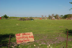 Tornado Damage - Not Insured. A spray painted sign requesting donations sits in a destroyed field after a Texas tornado swept through in Spring 2012. The sign Stock Images