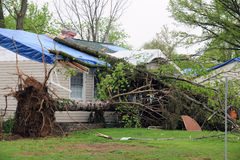 Tornado Damaged Homes. SAINT LOUIS, MISSOURI - APRIL 23: Damaged homes show tarp-covered roofs after tornadoes hit the Maryland Heights area on Friday April 22 Stock Photography