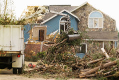 Tornado Damaged House with Tree Removal Equipment Royalty Free Stock Photo