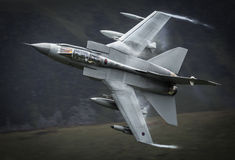 Tornado fighter jet. Royal Air Force RAF GR4 Tornado fighter jet making a high G force turn / maneuver Stock Photo
