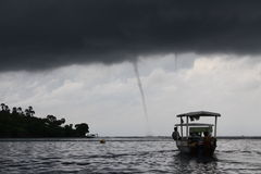 Tornado. Fisherman boat facing tornado at Indonesia tropics Royalty Free Stock Image