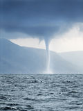 Tornado forming over sea. Tornado and storm clouds forming over rough sea Stock Images