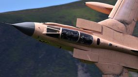 Tornado GR4 fighter bomber jet flying low level royalty free stock photos