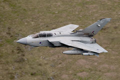 Tornado GR4. Royal Air Force Tornado GR4 low flying through the welsh mountains Royalty Free Stock Image