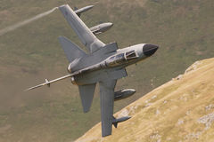 Tornado GR4. Royal Air Force Tornado GR4 low flying through the welsh mountains Stock Image