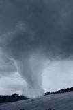 Tornado incoming. Wide tornado on the countryside in summer Royalty Free Stock Images