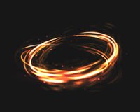 The tornado of light with sparkling lines. Bokeh particles on the swirling circles. Motion element on black background glowing light. Shiny gold color dodge Stock Image