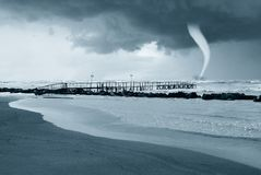 Tornado near the shoreline. Tornado over the stormy sea Royalty Free Stock Photography