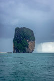 Tornado near small island in Krabi, Thailand. Krabi, Thailand - August 6, 2016: Small tornado near small rocky island in Krabi, Thailand Stock Photography