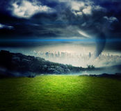 Tornado over city and moutains Royalty Free Stock Photos